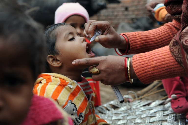 <p>A health worker gives a child polio drops on the outskirts of New Delhi, Jan. 17, 2012.</p>