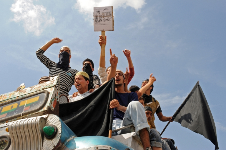 <p>Kashmiri muslim protesters shout pro-freedom slogans as they sit in a vehicle, during an anti-India protest, in Srinagar on the first day of Ramadan on August 12, 2010.</p>