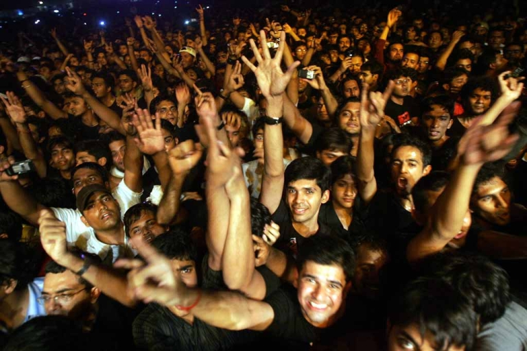 <p>Indian fans of British rock group Iron Maiden shout as their heroes perform during a concert in Bangalore.</p>