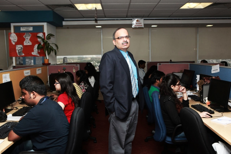 <p>Anup Bhasin, UnitedLex COO, with young lawyers working in the company's document review department.</p>