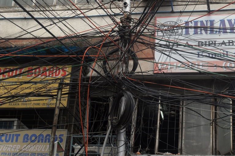 <p>An electric pole in Kolkata on July 31, 2012.</p>