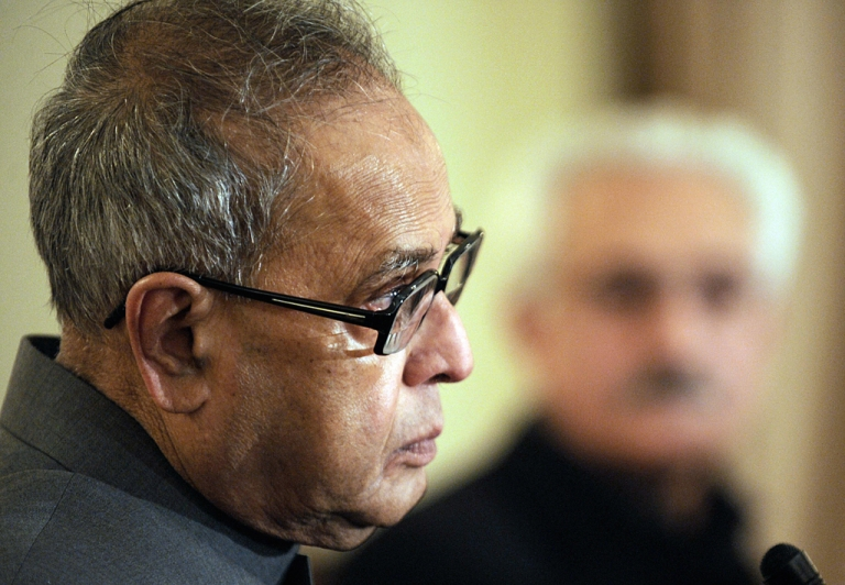<p>Indian Foreign Minister Pranab Mukherjee (L) speaks during a press conference as his Afghan counterpart Rangin Dadfar Spanta (R) looks on at the Foreign Ministry in Kabul on January 22, 2009.</p>