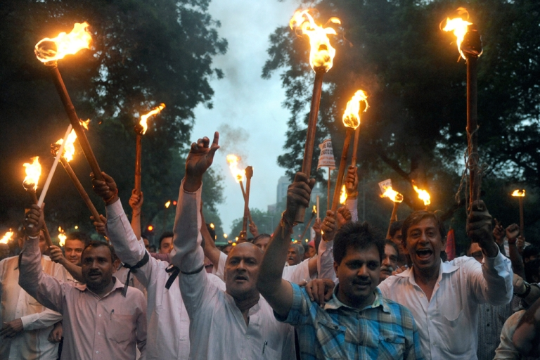 <p>Activists from India's main opposition Bharatiya Janata Party (BJP) hold lighted torches and candles during a protest march in New Delhi on August 16, 2011, against the arrest of  Indian social activist Anna Hazare.</p>