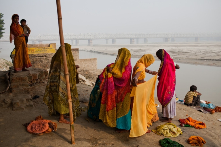 <p>Women dress their saris after having taken their morning bath in the Ganges river during the Sonepur Mela on November 15, 2011 in Sonepur near Patna, India. The cattle fair, held in the Indian state of Bihar, has its origins during ancient times, when people traded elephants and horses across the river Ganges.</p>