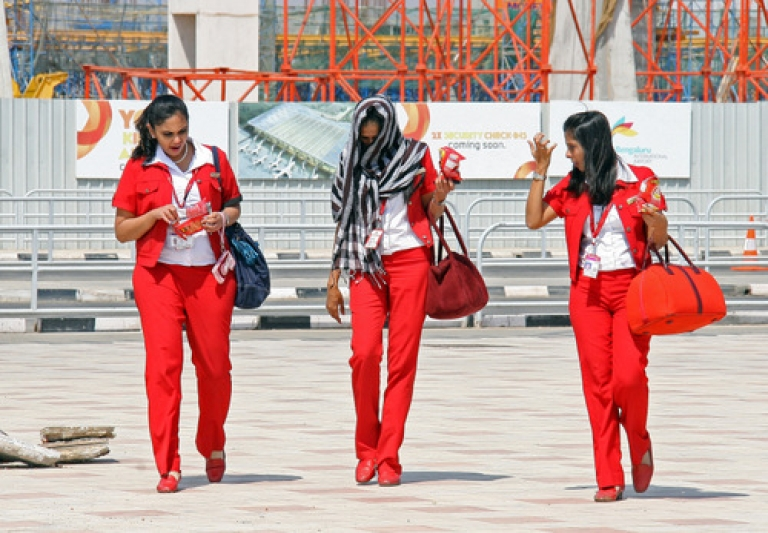 <p>Kingfisher Airlines air hostess leave Bangalore International Airport on February 21, 2012 in Bangalore. India's Kingfisher Airlines was struggling to avoid closure as regulators ordered it to prove its operational viability after mass cancellations of flights.</p>