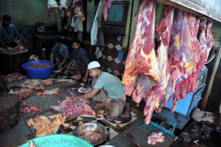 <p>Indian Muslim butchers prepare cuts of beef during the holy month of Ramadan in Hyderabad on August 4, 2011.</p>