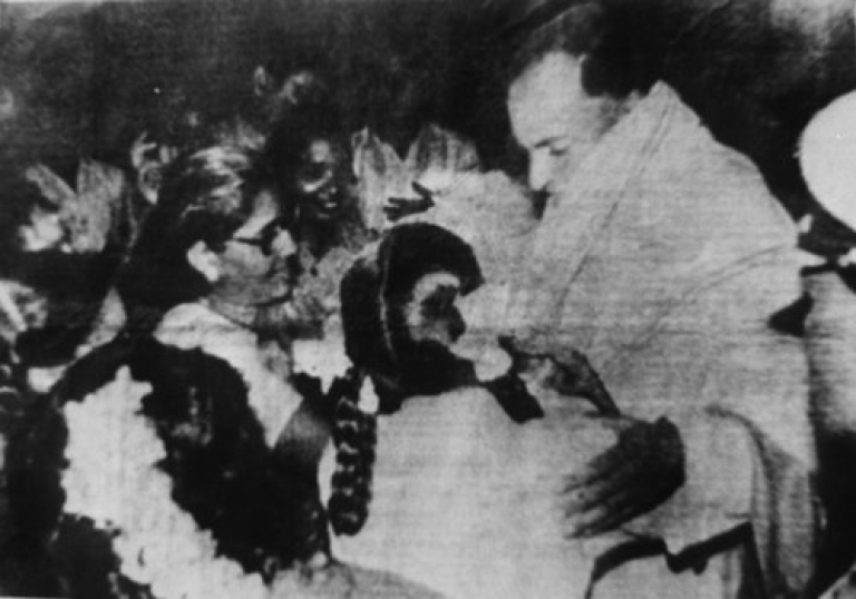 <p>A May 21, 1991 file photo shows Rajiv Gandhi being greeted as he arrives to make an address during his election campaign moments before he was killed by a suicide bomber in Sriperumbudur, Tamil Nadu State. The suspected Tamil guerrilla assassin is in the bottom left corner with flowers on her head.</p>
