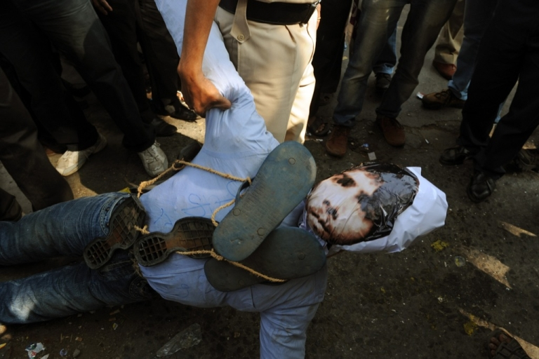 <p>An Indian policeman confiscates an effigy of Pakistan-born Mohammed Kasab, who was the sole surviving gunman of the 2008 Mumbai attacks, as activists celebrate his execution in Mumbai on November 21, 2012.</p>