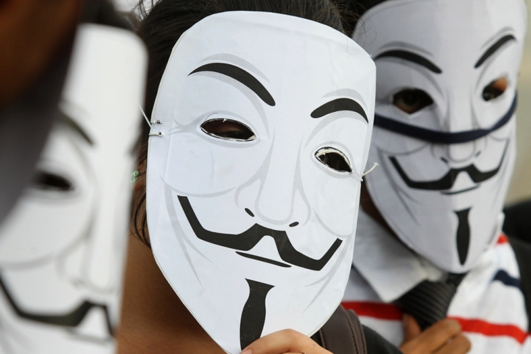 <p>Activists supporting the group Anonymous wear masks as they protest against the Indian Government's increasingly restrictive regulation of the internet outside a shopping mall in Bangalore on June 9, 2012.</p>