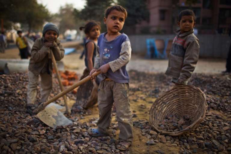 <p>Indian labourers work at a construction project in front of the Jawaharlal Nehru Stadium on January 30, 2010 in New Delhi, India.</p>