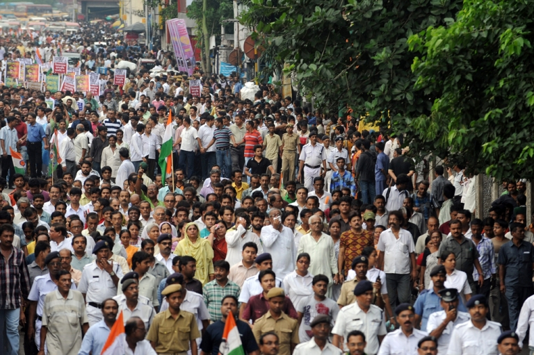 <p>Indian activists of the Trinamool Congress (TMC) with the chief minister of the eastern Indian state of West Bengal Mamta Banerjee (unseen) march during a demonstration against the foreign direct investment (FDI) in multi-brand retail in Kolkata on September 15, 2012. The TMC pulled out of India's ruling coalition on September 18, 2012.</p>