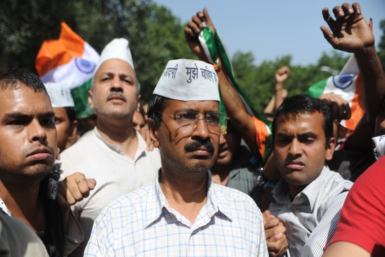 <p>Anti-corruption activist Arvind Kejriwal arrives to speak to supporters in October, 2012. Reporting on his allegations has landed some journalists and media companies in hot water with the accused politicians.</p>