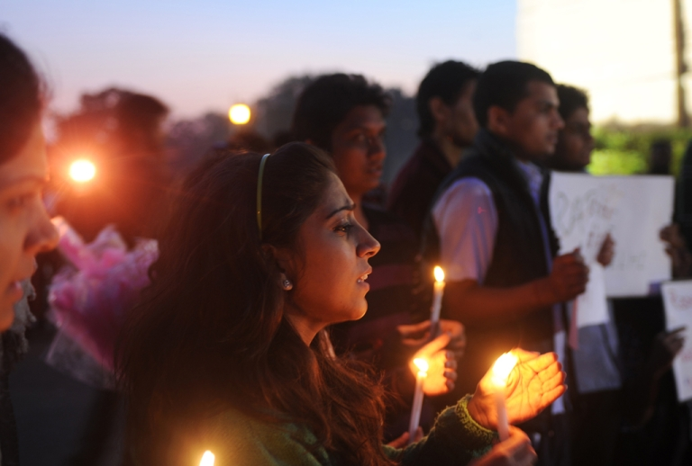 <p>Indian students and activists carry candles at India Gate during a protest following the gang-rape of a student in New Delhi on December 19, 2012.</p>
