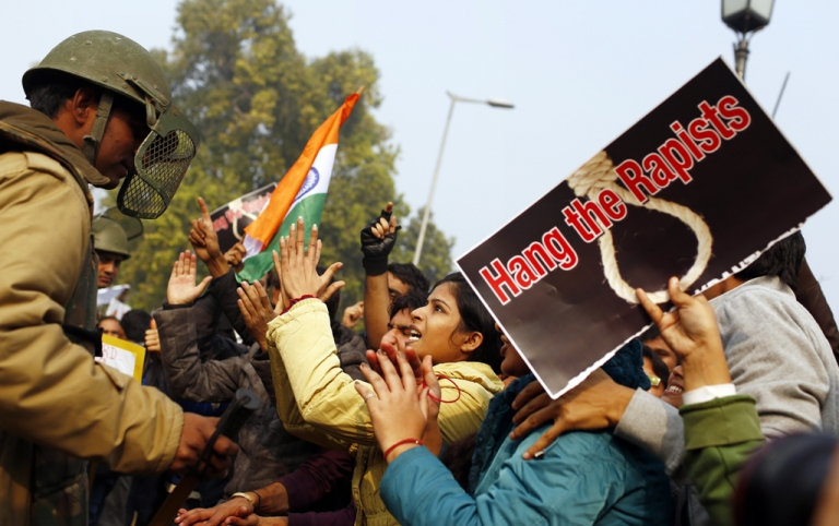 <p>An Indian demonstrator taunts the police during a protest calling for tougher anti-rape laws on December 23, 2012, following the gang-rape of a student in Delhi days earlier. India is set to pass tough new legislation increasing the penalties for convicted rapists.</p>