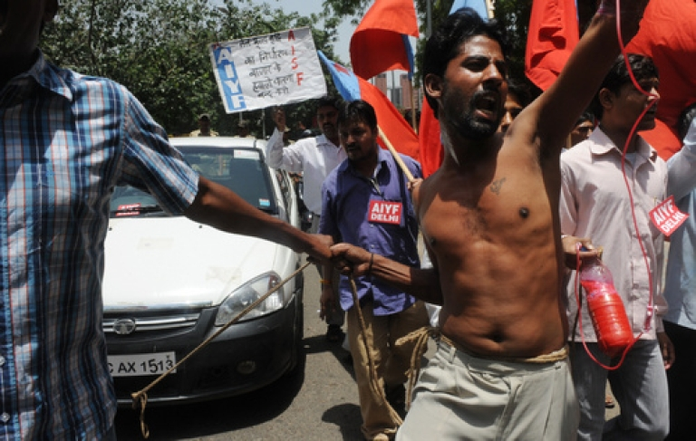 <p>Members from the All India Youth Federation  (AIYF) and All India Students Federation (AISF) shout anti-government slogans and pull a rope tied to a car during a protest against petrol price hikes in New Delhi on May 25, 2012. Indian state-run oil firms announced the sharpest hike in petrol prices in nearly a decade to offset growing losses caused by subsidised rates, rises in the international oil price and a plunging rupee.</p>