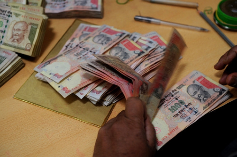 <p>Should they rename it the Droopee? India's currency hit a new all-time low on Wednesday, dropping to 54.52 rupees against the U.S. dollar. Despite the rupee's plunge of more than 20 percent over the past 12 months, analysts said India's currency won't go into freefall, as the central bank is committed to propping it up. But finance minister Pranab Mukherjee's halfhearted pledge to institute some austerity measures on Wednesday failed to spur much enthusiasm.</p>