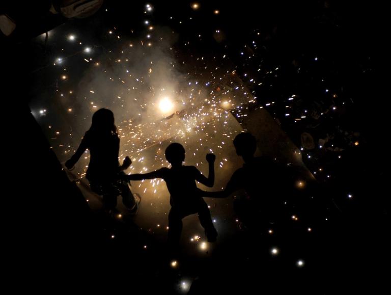 <p>Indian children in New Delhi light fireworks for Diwali, the Hindu festival of lights, on October 26, 2011.</p>