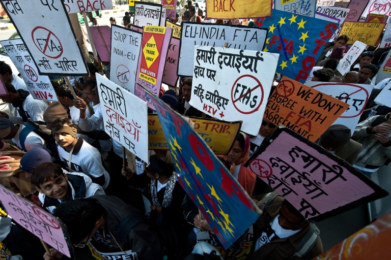 <p>HIV and AIDS campaigners carry placards during a protest rally in New Delhi on February 10, 2012 against the negative impact of the EU-India Free Trade Agreement (FTA) on affordable medicines across developing countries.</p>