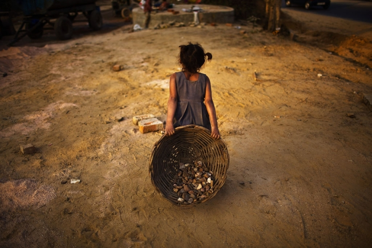 <p>Indian girl in front of the Jawaharlal Nehru Stadium on Jan. 30, 2010 in New Delhi.</p>