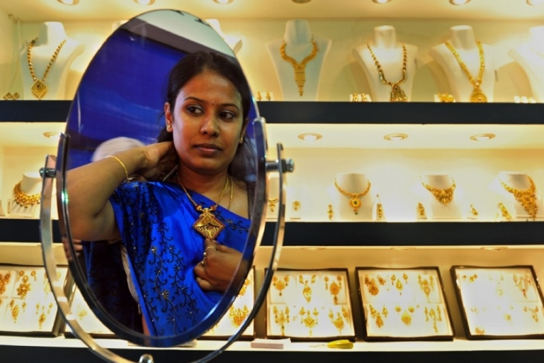 <p>An Indian customer tries on a piece of gold jewelry.</p>