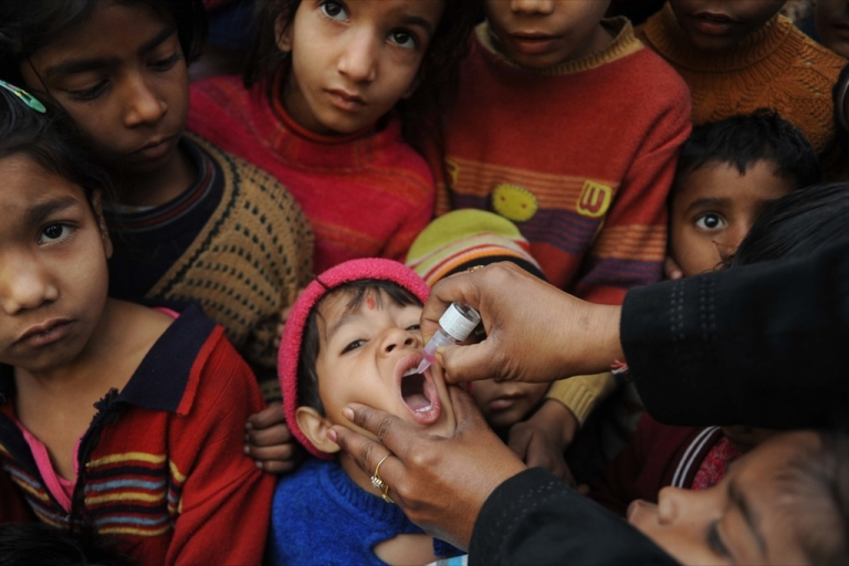 <p>An Indian boy receives anti-polio vaccination drops by an Indian Health worker as part of a Polio vaccination campaign in Amritsar on January 23, 2011.</p>