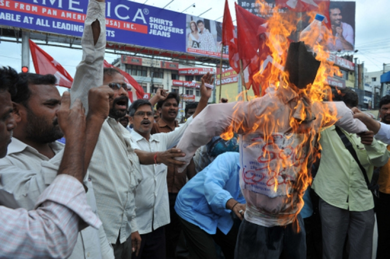 <p>Members of the Communist Party of India, Marxists(CPI-M) burn an effigy of United Progressive Alliance (UPA) government during a protest against petrol price rises in Hyderabad on September 16, 2011. Rising oil costs have contributed to a spike in inflation that is becoming a major headache for India as the rupee plunges against the dollar.</p>