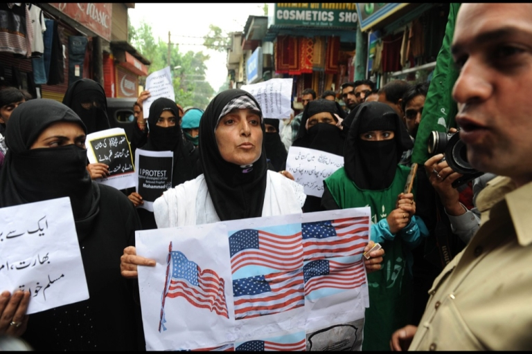 <p>Indian chairperson from the separatist group Muslim Khawateen Markaz, Yasmeen Raja (C), and her supporters shout anti-US slogans during a protest against an anti-Islam movie in Srinagar on Sept. 17, 2012. A total of 17 people have died in violence linked to the film, including four Americans killed in Benghazi, 11 protesters who died as police battled to defend US missions from mobs in Egypt, Lebanon, Sudan, Tunisia and Yemen, and the two US soldiers in Afghanistan.</p>