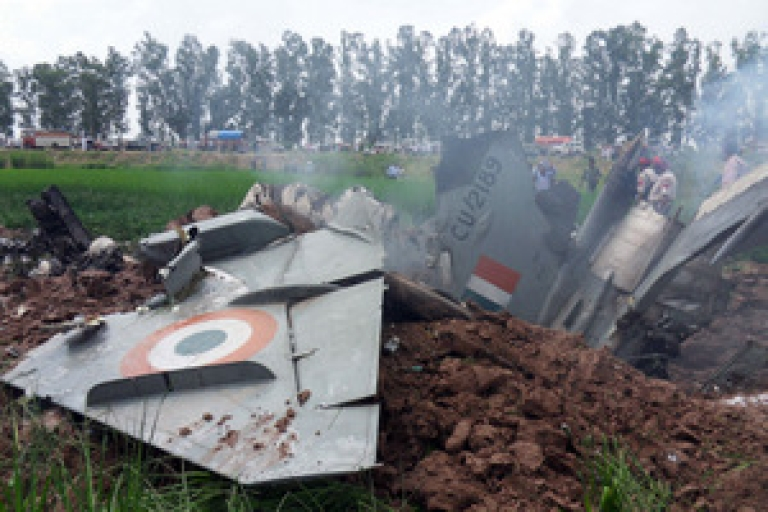 <p>Indian Air Force personnel stand by the wreckage of a MiG-21 aircraft that crashed in a field in Rajgarh, in Patiala district on September 6, 2011. An Indian air force MiG-21 fighter jet crashed in the northern state of Punjab, the pilot ejected safely, causing no casualties. The Russian-designed jet came down near the town of Rajpura, some 30 kms from Patiala.</p>