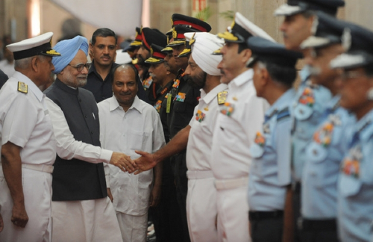 <p>Indian Prime MInister Manmohan Singh (2L) shakes hands with the commanders of the Indian armed forces as Indian Defence Minister A. K. Anthony (3L) looks on during the inauguration of a five day long Annual Combined Commanders conference in New Delhi on October 11, 2011.</p>