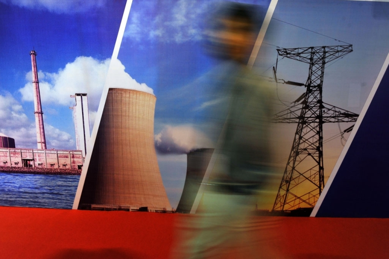<p>A delegate of the India Nuclear Energy 2011 summit walks past a stall in Mumbai on Sept. 29, 2011.</p>