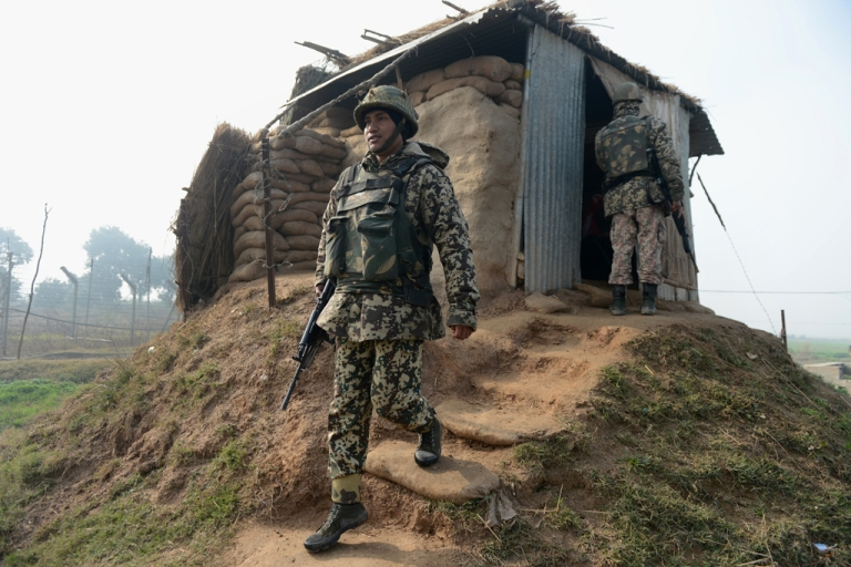 <p>An Indian Border Security Force soldier keeps watch at an outpost along the India-Pakistan border in Suchit-Garh.</p>