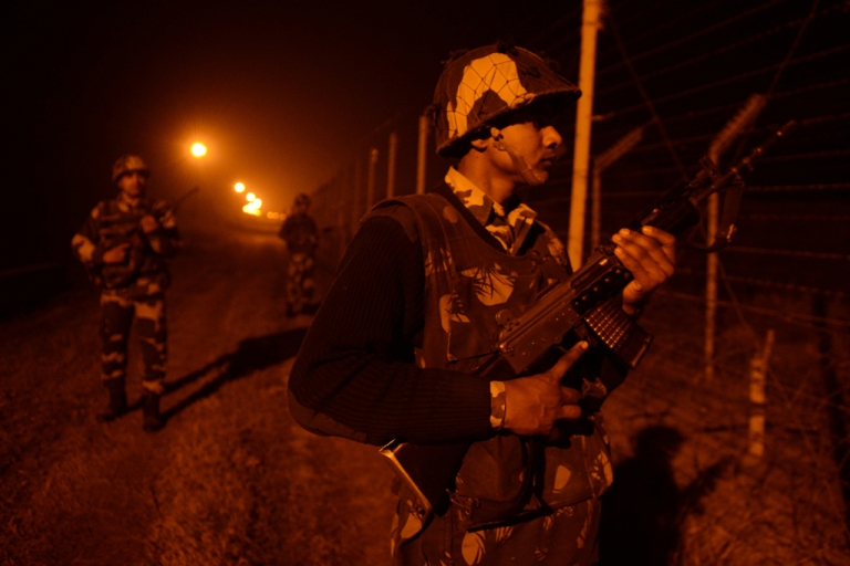<p>An Indian Border Security Force (BSF) soldiers patrol along the border fence at an outpost along the India-Pakistan border in Suchit-Garh, 36 kms southwest of Jammu on January 11, 2013. Pakistan summoned the Indian ambassador to protest against