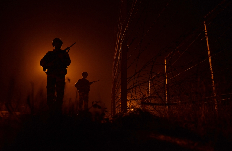 <p>An Indian Border Security Force (BSF) soldiers patrols along the border fence at an outpost along the India-Pakistan border in Suchit-Garh, 36 kms southwest of Jammu on January 11, 2013. Pakistan summoned the Indian ambassador to protest against