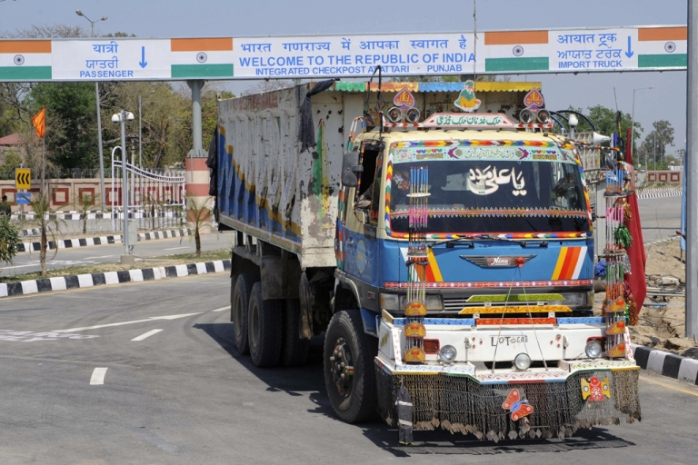 <p>A Pakistani truck, pictured after transporting a shipment of goods, drives through the newly-constructed Integrated Checkpost (ICP) at the India-Pakistan border in Wagah on April 12, 2012. India has also agreed to allow foreign direct investment from Pakistan as of April 13, 2012.</p>
