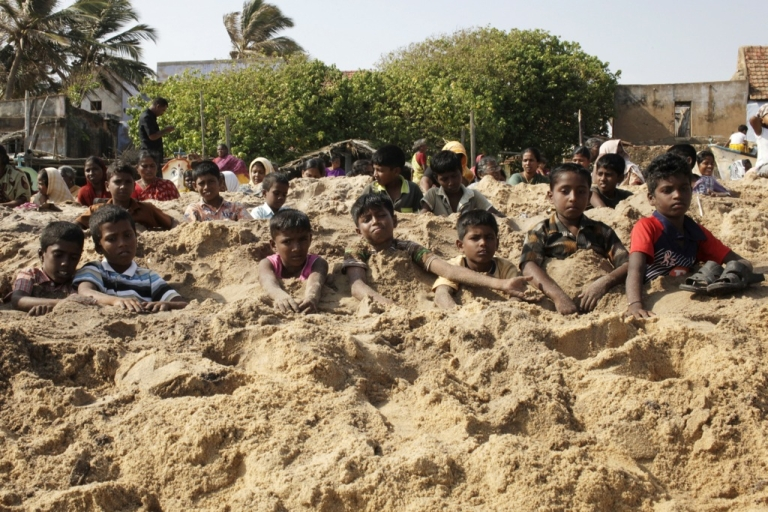 <p>Indian anti-nuclear activists bury themselves in sand as part of a protest, demanding that uranium fuel stop being loaded in the nuclear reactor of Koodankulam Nuclear Power Project (KKNPP) on the beach at Idinthakarai village in southern Tamil Nadu on September 26, 2012.</p>