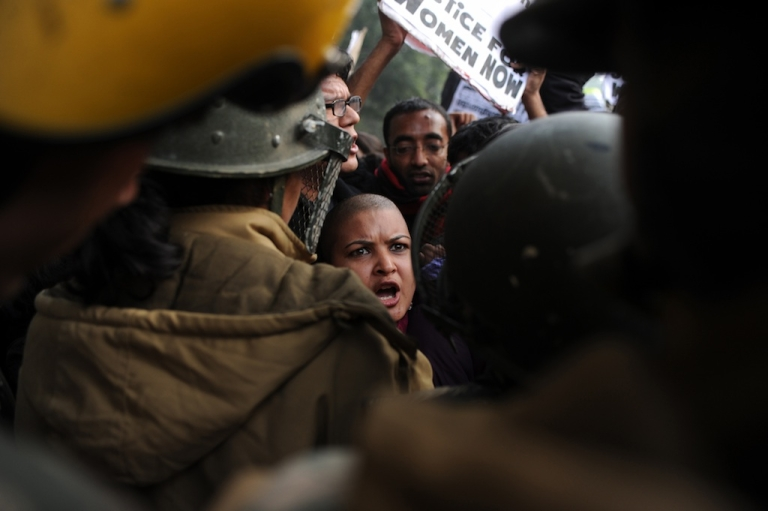 <p>Indian demonstrators shout slogans and wave placards as they move towards India Gate in New Delhi on December 27, 2012, during a protest calling for better safety for women following the rape of a student in the Indian capital. Three of the five men accused of gang rape and attempted murder will plead not guilty.</p>