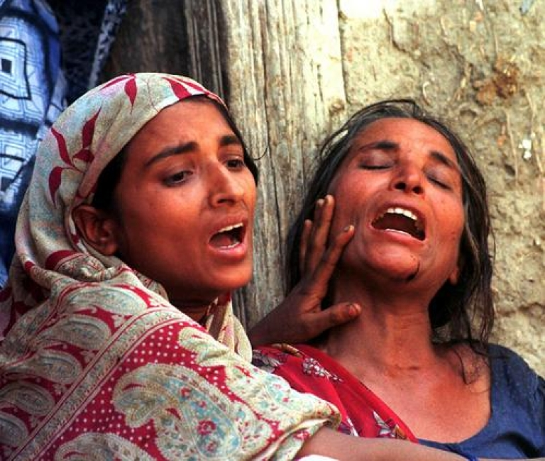 <p>SENARI, INDIA:  Widows of upper caste Hindu landlords weep during the cremation of their husbands, who were killed by Maoist guerrillas, in 1999. On Friday, Brahmeshwar Singh, chief of an upper caste militia known as the Ranvir Sena, was killed by unidentified gunmen. A Ku Klux Klan-style outfit, the Ranvir Sena has killed dozens of lower caste Indians. Singh was allegedly a participant in several of these killings, including the Laxmanpur Bathe massacre of 61 Dalits in December 1996.</p>