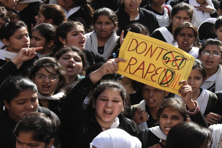 <p>Indian students shout slogans as they wave a placard during a demonstration in Jammu on December 20, 2012, as they protest the rape of a young woman in the Indian capital. Riot police fired water cannon on December 19, at a protest in New Delhi over the gang-rape of a 23-year-old student who was left fighting for her life as outrage against the brutal attack grew across India.</p>