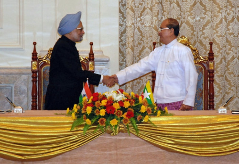 <p>Visiting Indian Prime Minister Manmohan Singh (L) shakes hands with Myanmar President Thein Sein during their meeting at the president's house in Naypyidaw on May 28, 2012.  India's prime minister signed a raft of deals with Myanmar on May 28 in a historic visit aimed at boosting trade and energy links and contesting the influence of regional rival China.</p>