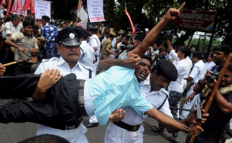 <p>Activists of Social Unity Center of India (SUCI) scuffle with police officials as they attempt to arrest them during a law-violation protest against the recent petrol price hike in Kolkata on May 31. Following the revelation that India's economic growth dropped to 5.3 percent in the fourth quarter -- the lowest rate in nine years -- economists, investors and journalists are asking whether the wheels have come off.</p>