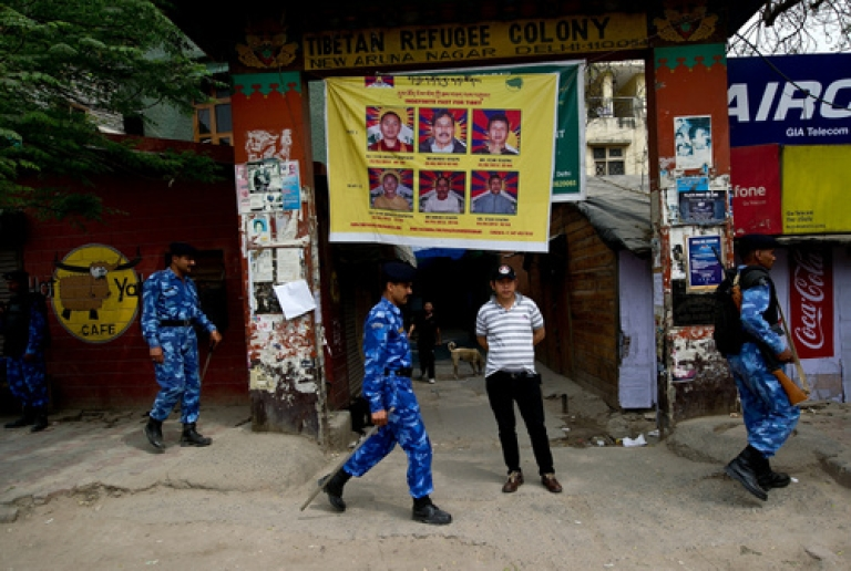 <p>India put New Delhi's community of Tibetan exiles under collective house arrest Wednesday, implementing a rarely used legal provision, after a Tibetan demonstrator set himself on fire outside the parliament building to protest the visit of Chinese President Hu Jintao. Hu will attend the BRICS Summit on Thursday and hold separate bilateral talks with Indian Prime Minister Manmohan Singh.</p>