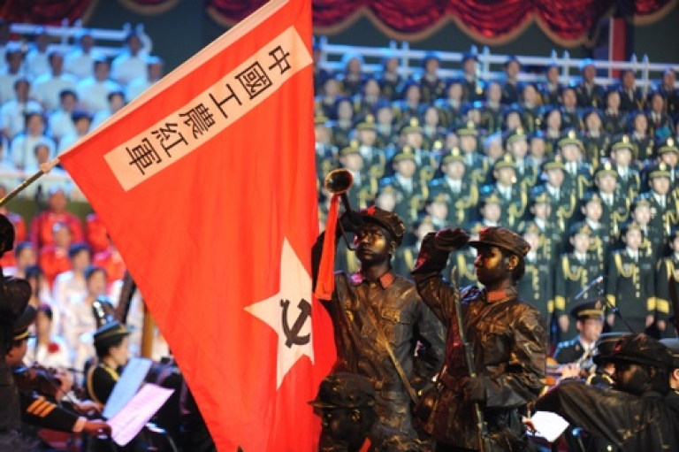 <p>Soldiers and civilians perform red songs at Shijingshan Stadium on June 21, 2011 in Beijing, China. This year's celebrations will mark the 90th anniversary of the founding of the Communist Party of China.</p>