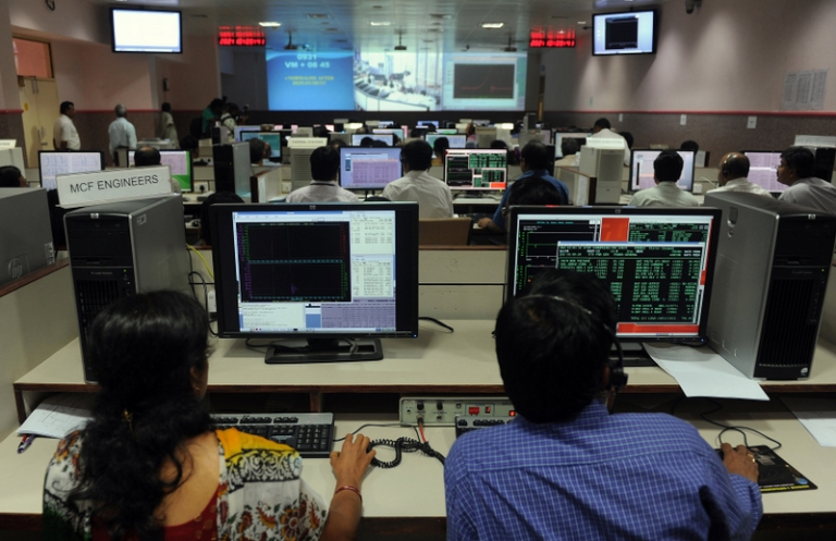 <p>Indian scientists watch displays as they sit in The Satellite Control Centre (SCC) of The Indian Space Research Organisation's (ISRO) Master Control Facility (MCF) in the district of Hassan some 210kms from Bangalore on July 21, 2011, as they monitor the deployment of India's communication satellite, GSAT-12 in geo-synchronous orbit.</p>