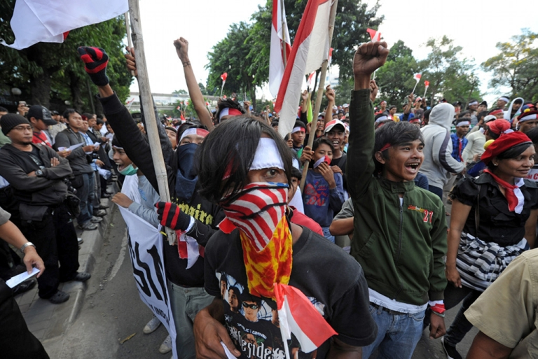 <p>Indonesian protesters shout slogans during a protest against the Malaysian government following a border disputes between the two countries on Aug. 26, 2010.</p>