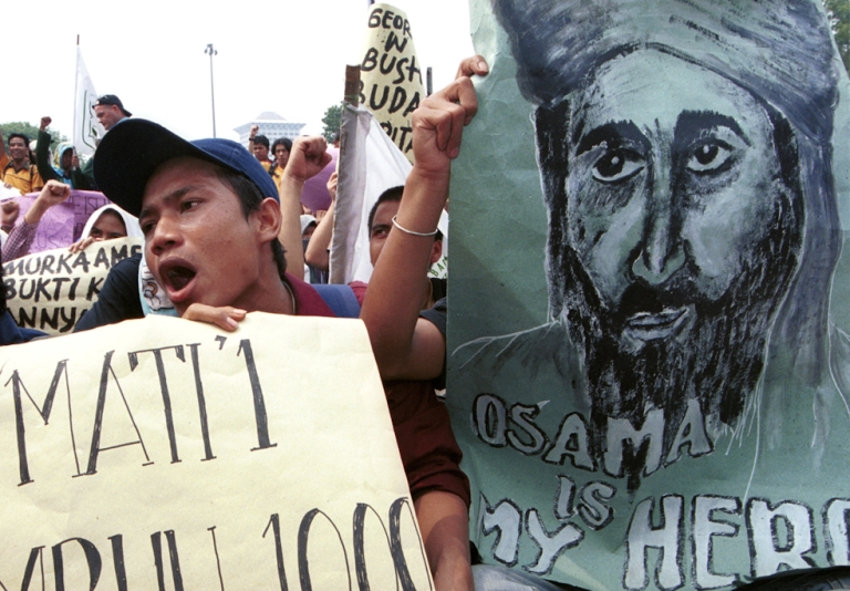 <p>Hundreds of Indonesian Muslim students shout 'Allah O Akbar' and hold posters of suspected terrorist Osama Bin Laden September 26, 2001 during a protest outside the U.S. Embassy in Jakarta, Indonesia. The student protest was in reaction to anticipated U.S. retaliatory attacks against terrorists in Afghanistan.</p>