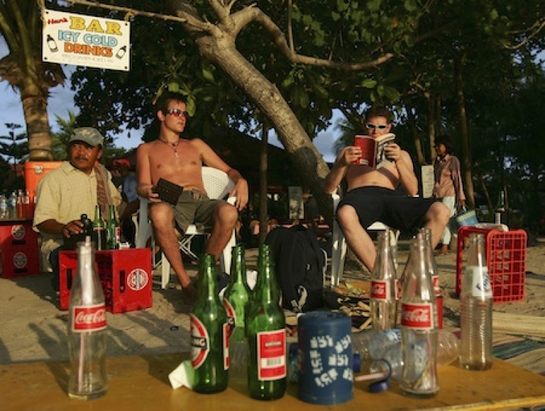 <p>British tourists enjoy a beer at sunset on October 3, 2005 in Bali, Indonesia.</p>