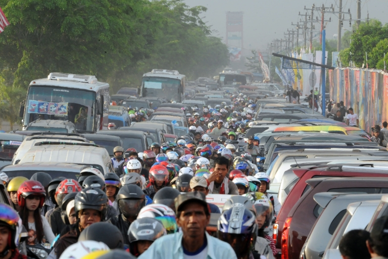 <p>Motorists inch their way in a heavy traffic in Sumatra, Indonesia, on November 19, 2011.</p>