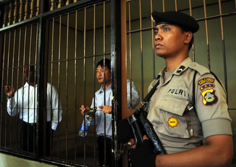 <p>An Indonesian policeman stands guard in a Bali prison in 2010.</p>