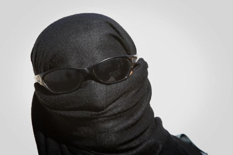 <p>An Afghan policewoman stands guard during a ceremony to mark International Women's Day in Lashkar Gah in Helmand province on Mar. 8, 2010.</p>