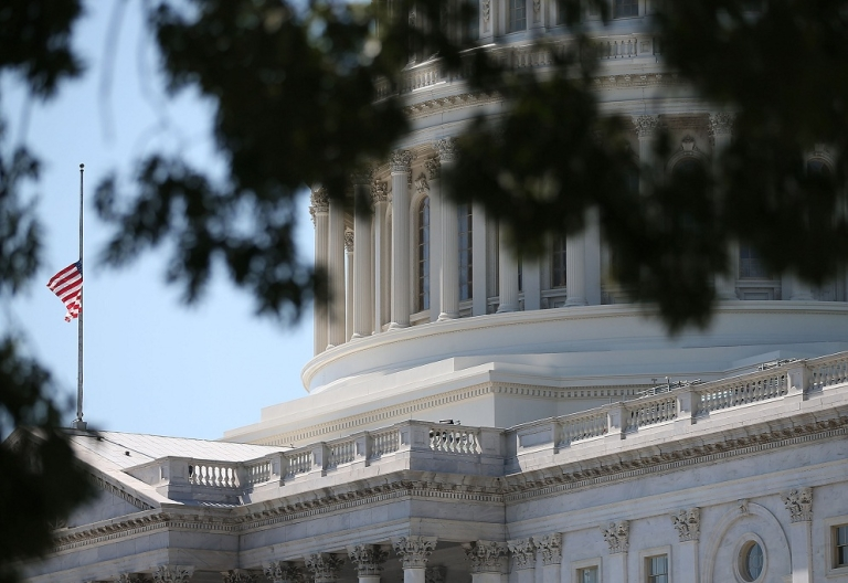<p>The American flag stands at half-staff at the U.S. Capitol September 12, 2012 in Washington, DC. The flag was lowered for U.S. ambassador to Libya J. Christopher Stevens and three other embassy employees who were killed when the embassy in Benghazi was attacked by a mob potentially angered by an American-made video mocking Islam's founding prophet.</p>